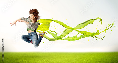 Leinwandbild Motiv Pretty girl jumping with green abstract liquid dress