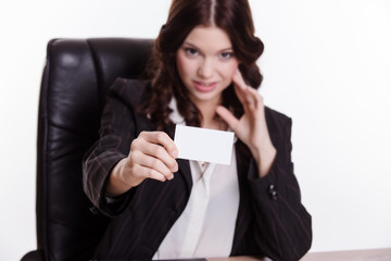 Elegant business woman shows the business card in the office