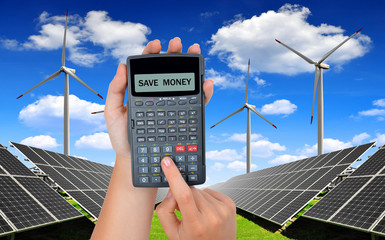 Solar panels and wind turbines.Concept of saving money.