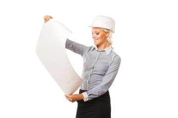 Young female construction specialist looking on blueprints
