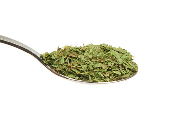 Dried tarragon on a teaspoon