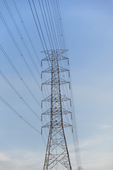 High voltage electricity post with blu sky