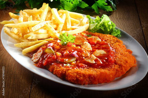 Saucy Crumbled Zigeunerschnitzel with Fries on Plate - 78146023