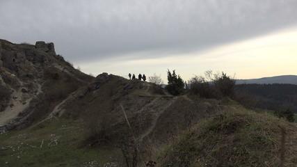 Fantasy Group Walking Along Mountain Path