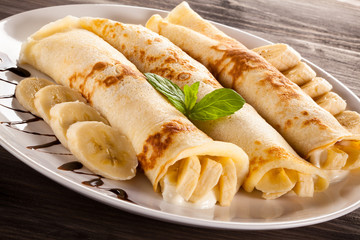 Pancakes with cream and bananas