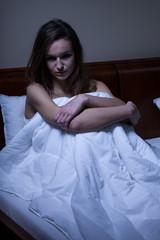 Awake woman in her bed