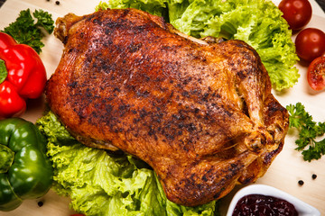 Roast duck on cutting board