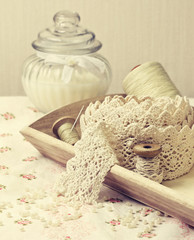 lace ribbon, old spools of thread in vintage style