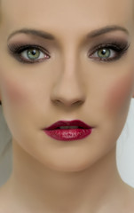 Close up portrait of beautiful woman model with dark makeup. Fas
