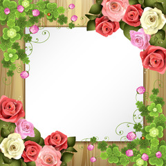 Wood background with sheet of paper, clover and roses