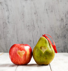 Fresh apple and pear with heart for Valentine Day