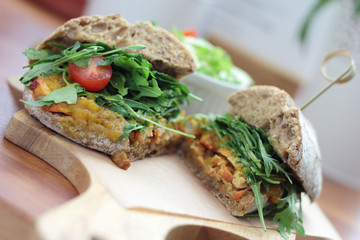 Bombay masala sandwich with chicken, rocket and green salad.