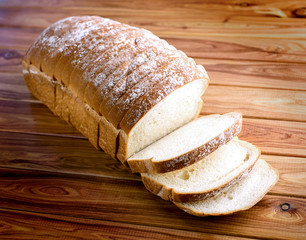 Loaf of bread on wooden background