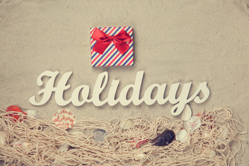 Gift and word Holidays with net and shells