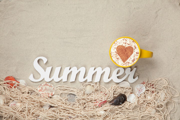 Cup, word Summer and net with shells on sand