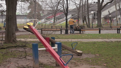Father collected logs in the park for heating,poverty