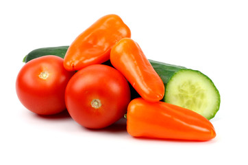 cucumber tomatoes and peppers on a white background