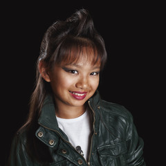 Asian girl - rocker with a fashionable haircut smiling