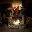 Christmas stocking on fireplace background.