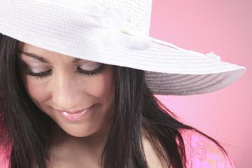 Gorgeous woman wearing a white garden hat.