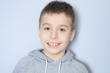 Portrait of a boy in front of a gray background