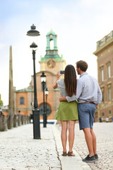 Tourist couple taking travel pictures in Stockholm