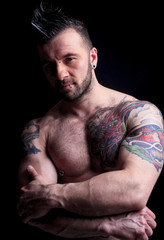 A urban man in front of dark background