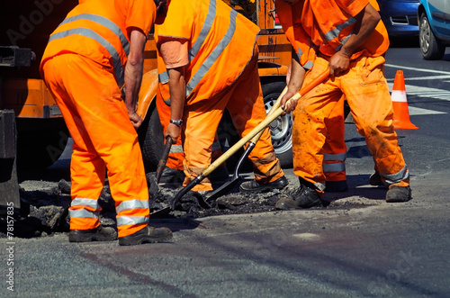 poster of Construction workers are working at the road construction