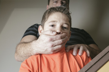 A father abused his young boy at home