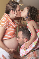 new home for newborn. Familly give kiss on belly.