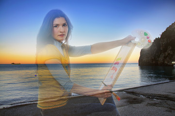 Double exposure girl artist on a background of sea sunset