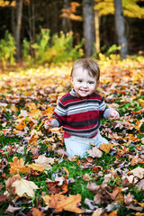 Happy Toddler Smiles Outside in the Autumn