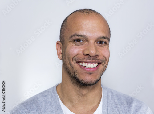 canvas print picture Portrait of a man in a tee shirt smiling to camera