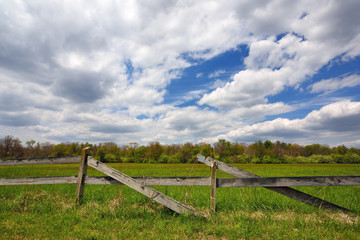 Wooden fence and an open field