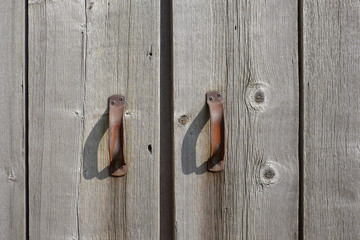 Rusted Iron Handles on an old farm door