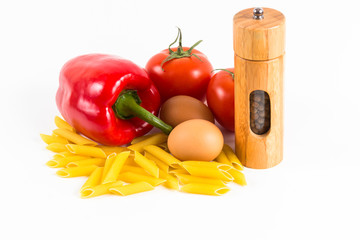 Pasta, tomatoes and spices on a white background
