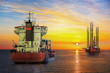 canvas print picture - Tanker ship and Oil Platform on offshore area at sunset.