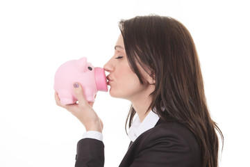 Glasses sale concept. Happy woman kissing piggy bank wearing eye