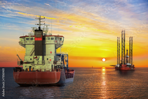canvas print picture Tanker ship and Oil Platform on offshore area at sunset.