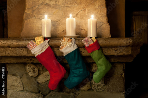 Foto op Canvas Carnaval Christmas stocking on fireplace background