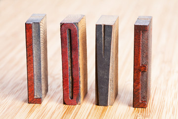 """Love"" written with colored vintage letterpress"