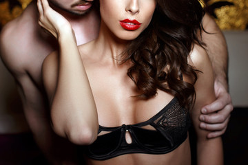 Sensual brunette woman in underwear with young lover closeup