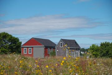Coastal weathered barns near a coastal town