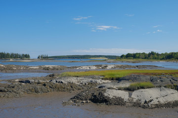 A secluded small bay and estuary at low tide showing the large g