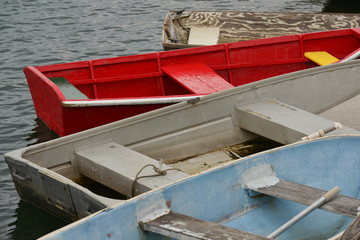 Wooden and metal rowboats and skiffs docked