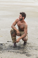 Muscled Shirtless Soldier in Camouflage Pants and Black Shoes on