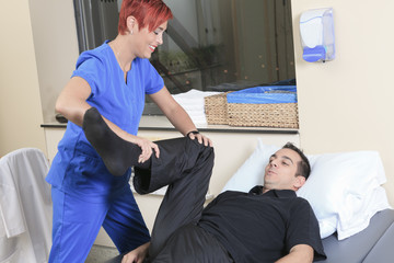 A physiotherapist woman help client at job