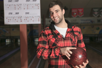 A bowling player in the alley