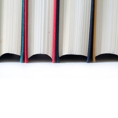 Old books. Close-up. Soft focus. White background. Isolated.