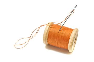 spool of orange thread